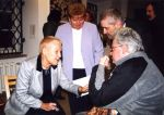 Vernissage of the exhibition of THE MEGALITH, 2002. Elżbieta Dzikowska talks with a director Wiesław Banach and a poet Janusz Szuber